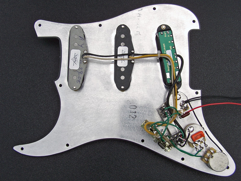 the fat strat project the only visible scratch on the 2002 body as pictured above it is just to the left of the tremolo cover and centered vertically